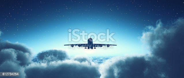 istock Airplane flying over cloudy sky. 612734254