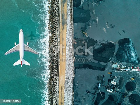 Airplane flying over Coal mineral exploitation