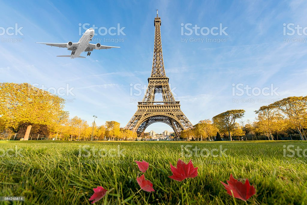 Airplane flying over Eiffel Tower, Paris, France. stock photo
