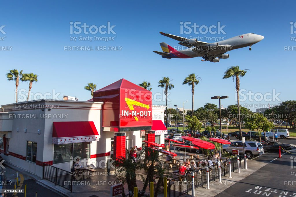 Airplane flying over In-n-Out Burger, LAX stock photo