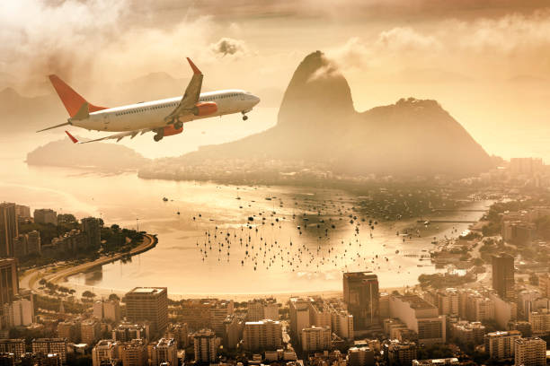 Airplane flying over Rio de Janeiro Guanabara Bay with Sugarloaf Mountain stock photo