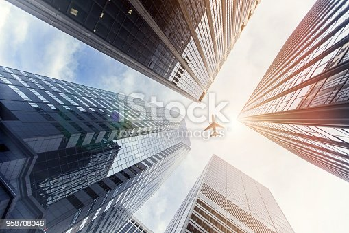 182061540 istock photo Airplane Flying Over Skyscrapers in New York 958708046