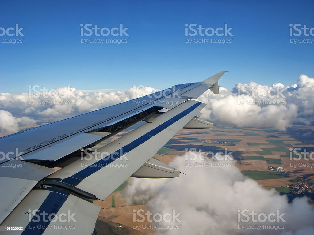 Airplane flying over the Clouds stock photo