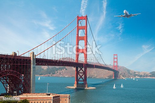 istock Airplane flying over the Golden Gate Bridge in San Francisco 534403356
