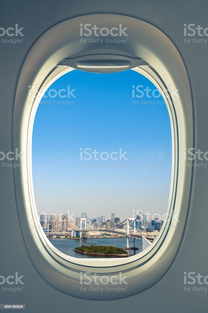 Airplane flying over Tokyo stock photo