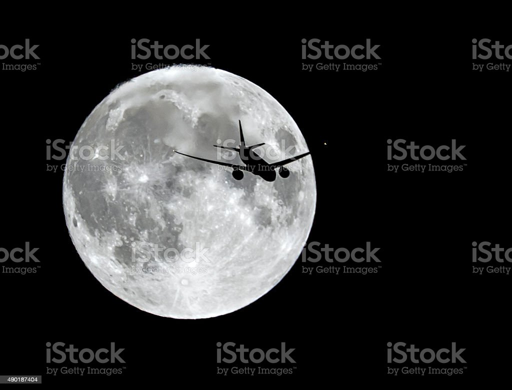 Airplane flying to the moon stock photo
