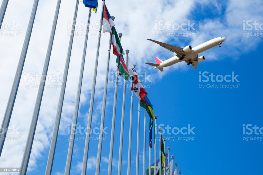 Airplane flyover the National flags stock photo