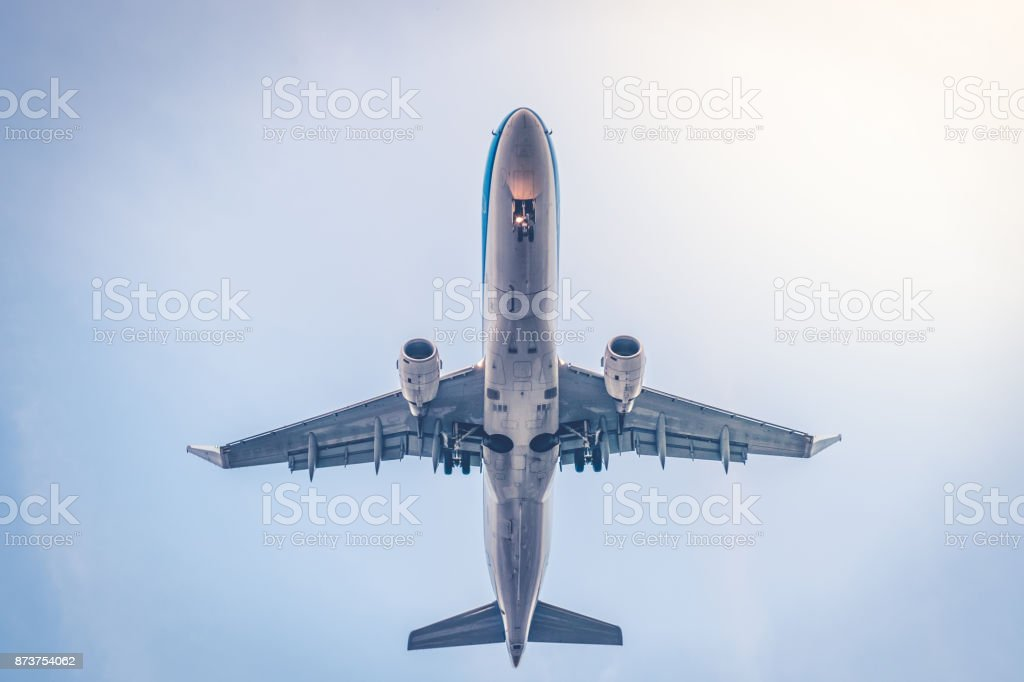 airplane from beneath , aircraft flying from below stock photo