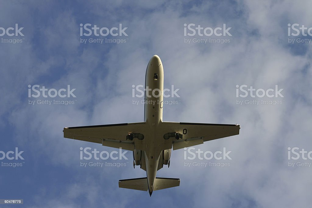 Airplane from underneath royalty-free stock photo