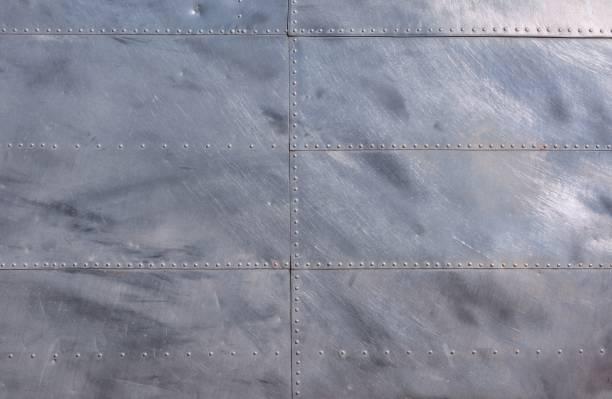 Airplane fuselage silver metal texture. stock photo