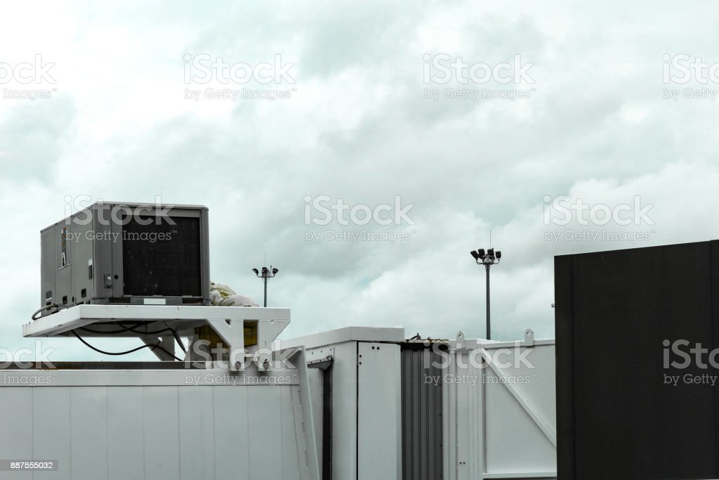 Airplane gangway in Boston Massachusetts before heavy clouds, May 15 2017 stock photo