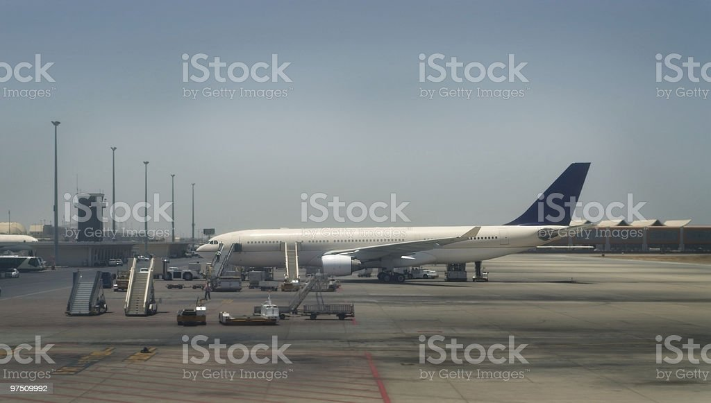 Airplane getting ready for passengers stock photo