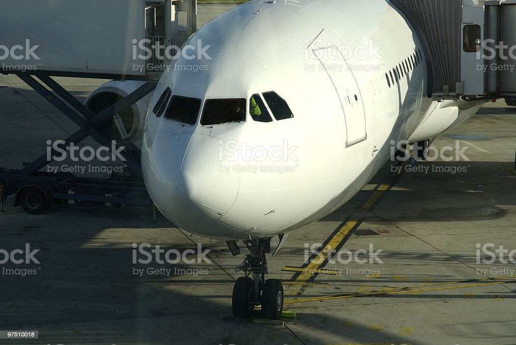 Airplane getting ready to accept passengers for boarding royalty-free stock photo