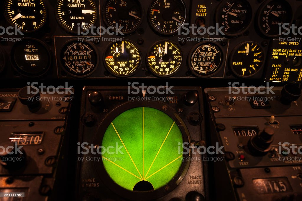 Airplane green glowing radar with aircraft gauges, switches, and knobs stock photo