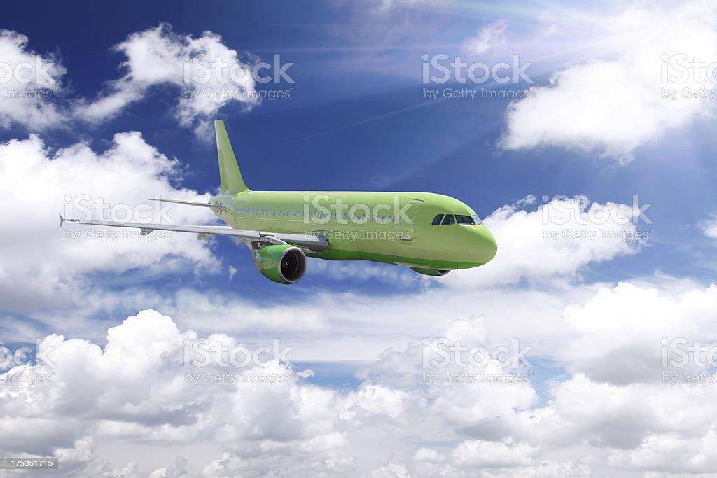 Airplane in a sky with clouds. royalty-free stock photo