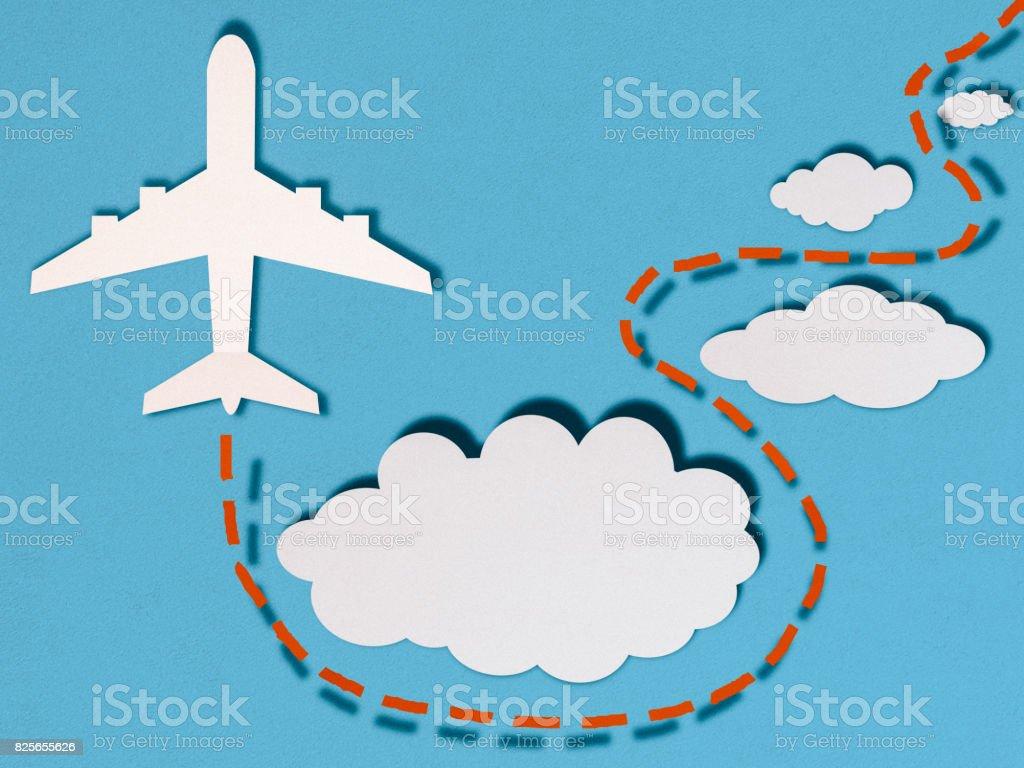 Avion dans les nuages, style coupe papier - Photo