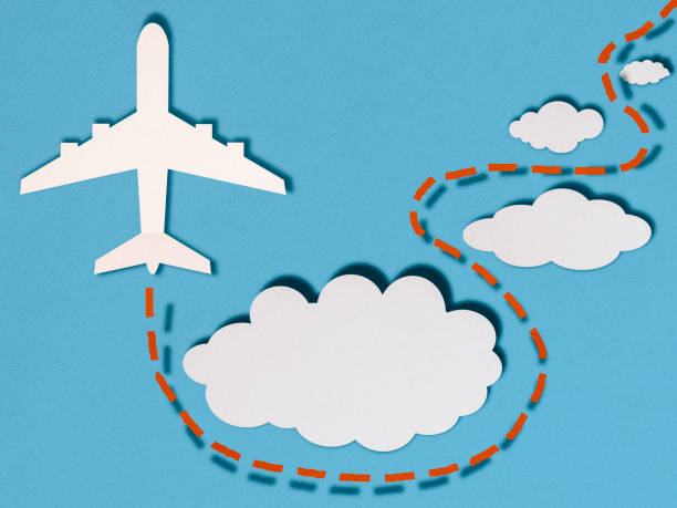 Airplane in clouds, paper cutting style stock photo