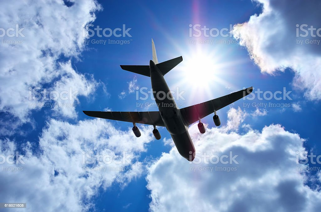 Airplane in deep blue sky stock photo