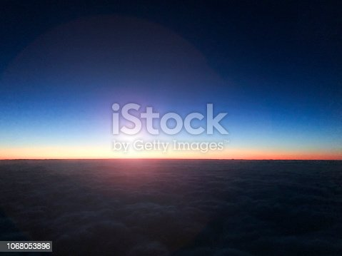 816320512 istock photo Airplane in flight at sunrise. 1068053896
