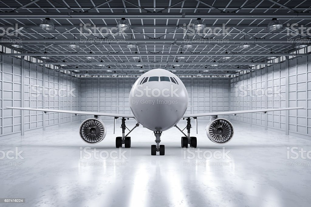 airplane in hangar stock photo