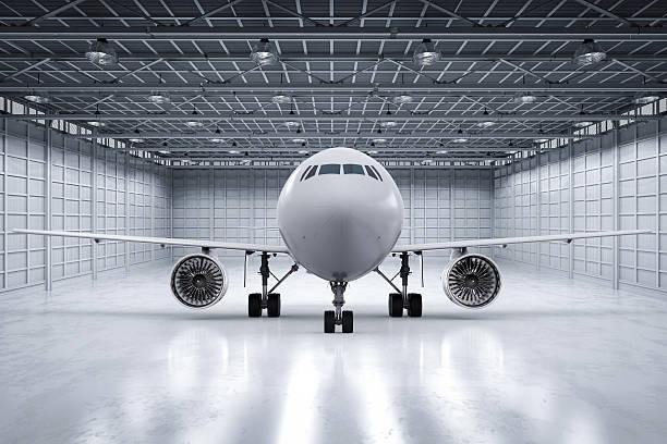 airplane in hangar stock photo