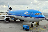 'Amsterdam, The Netherlands - May 15th, 2012: A KLM Royal Duch Airlines airplane waiting to be supported, Amsterdam International Airport Schipol; plane named after Audrey Hepburn.'