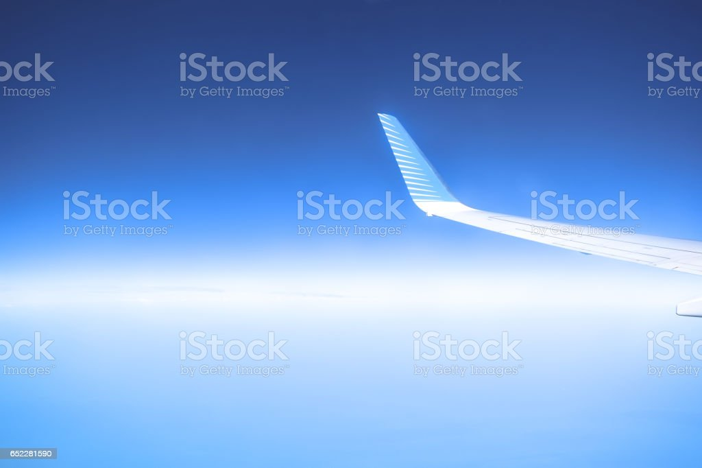 Airplane in the blue sky stock photo