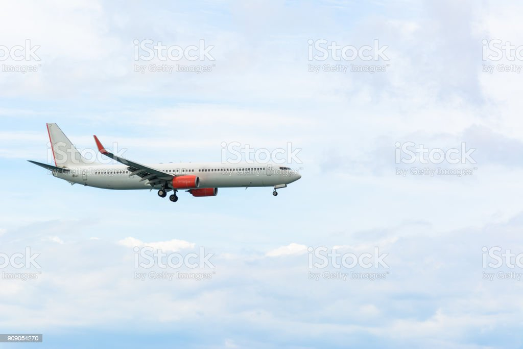 Airplane in the cloudy sky for background stock photo