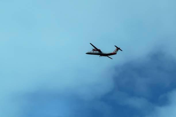 Airplane in the sky above Düsseldorf international aeroport stock photo