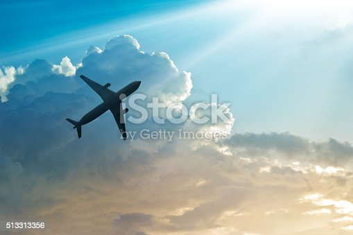 istock Airplane in the sky and cloud at sunrise 513313356