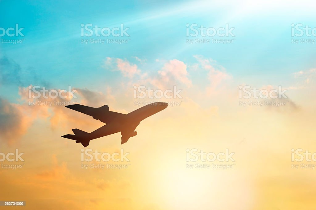 Airplane in the sky and cloud at sunset - foto de stock