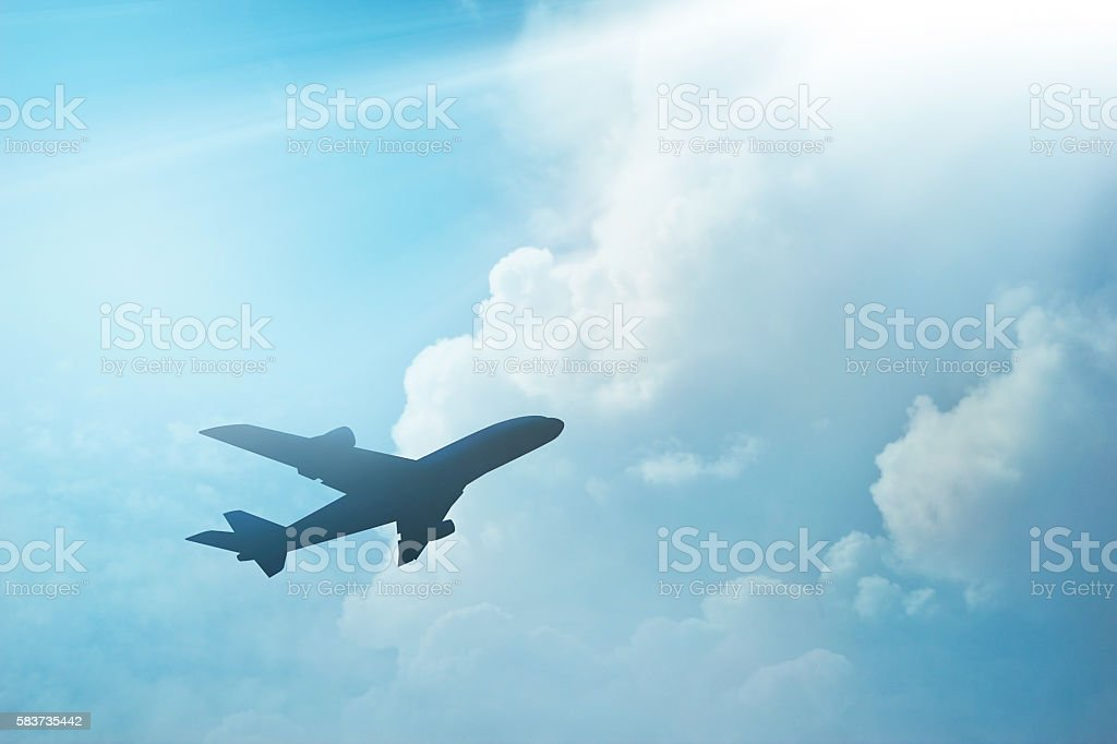 Airplane in the sky and cloud at sunset stock photo