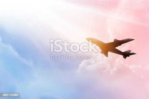 istock Airplane in the sky and cloud colorful at sunset 583733982