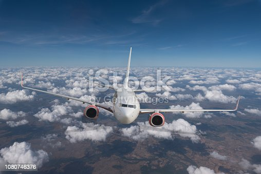 istock Airplane in the sky at blue sky. 1080746376