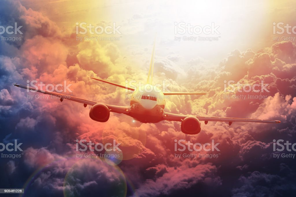 Airplane in the sky at sunset. boing stock photo
