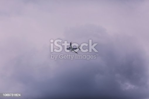 istock Airplane in the sky 1069731824
