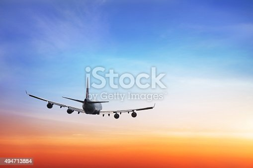 istock airplane in the sky 494713884
