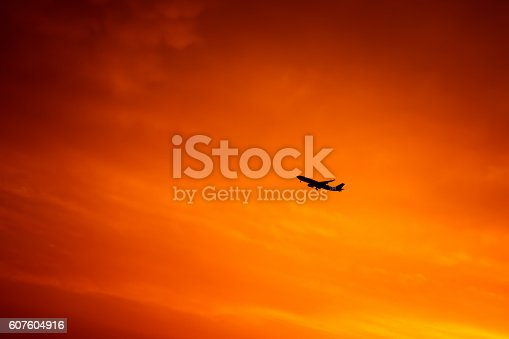 istock Airplane in the sky 607604916