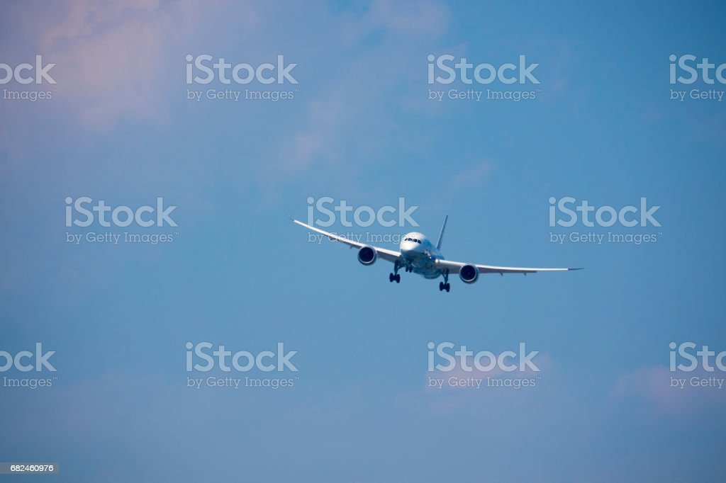 Airplane in the sky royalty-free stock photo