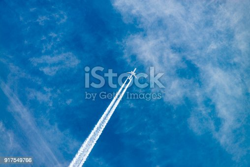 An aircraft in the sky seen from the ground.