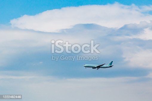 864534880 istock photo Airplane in the Sky with Landing Gear Engaged 1222462446