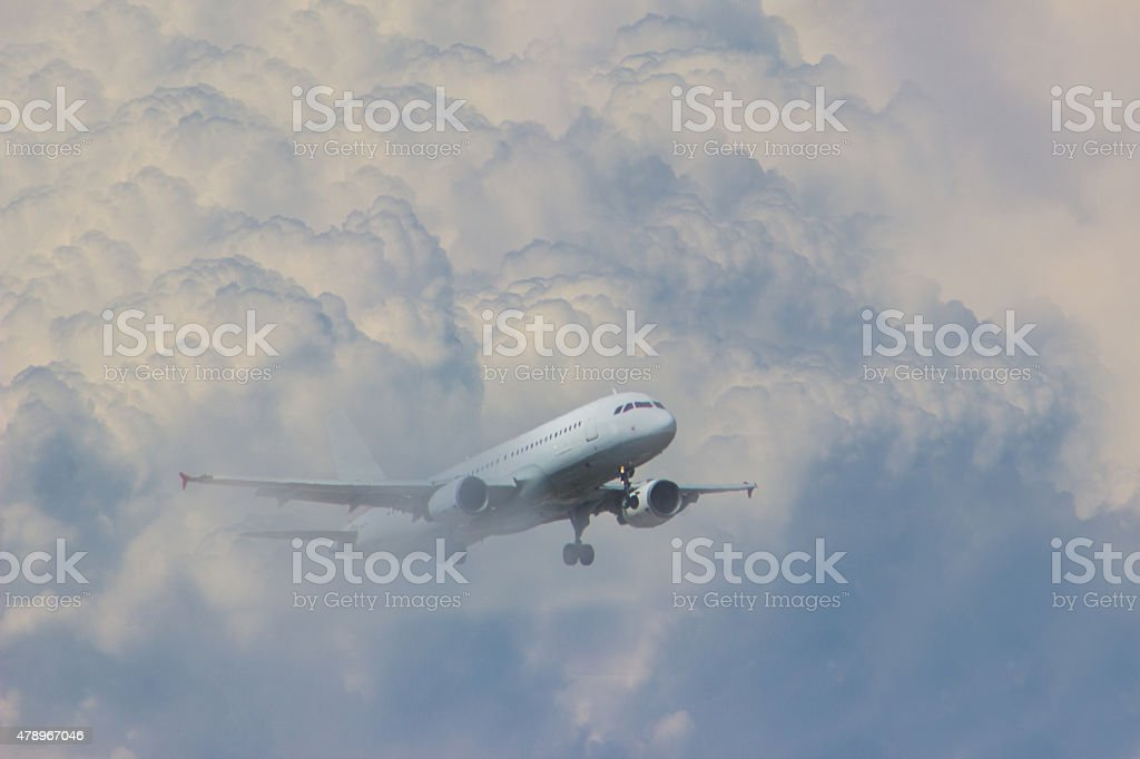 Airplane inside of clouds moving up stock photo