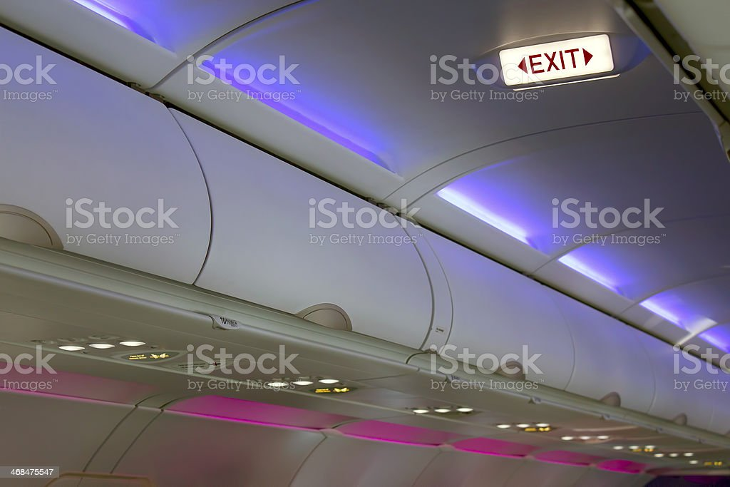 Airplane interior lighting and signs royalty-free stock photo