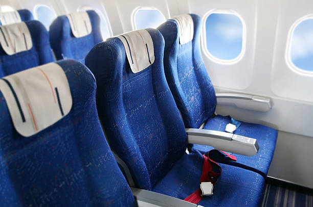 Airplane interior seat rows in a commercial airplane cabin airplane seat stock pictures, royalty-free photos & images