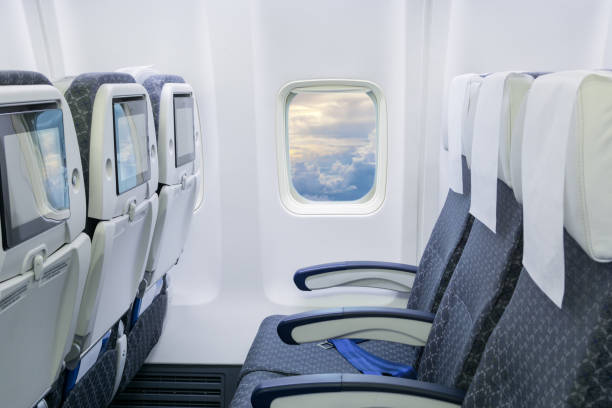 airplane interior Seat Rows inside an Airplane passenger cabin stock pictures, royalty-free photos & images