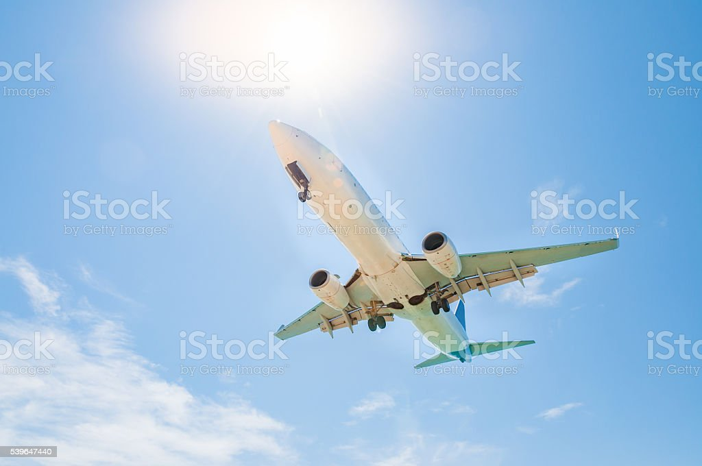 Airplane is about to landing at the airport stock photo