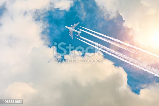 Airplane jet fly high in sky, a journey through the clouds and a sunny glare