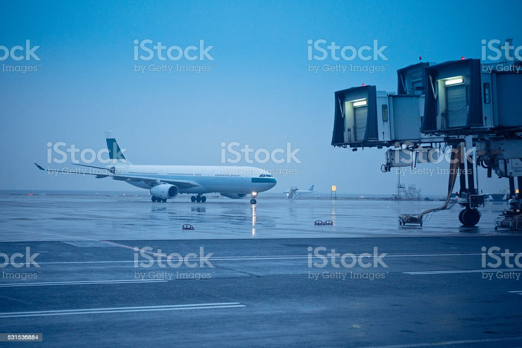 Airplane Landed and Moving on the Airport Runway stock photo