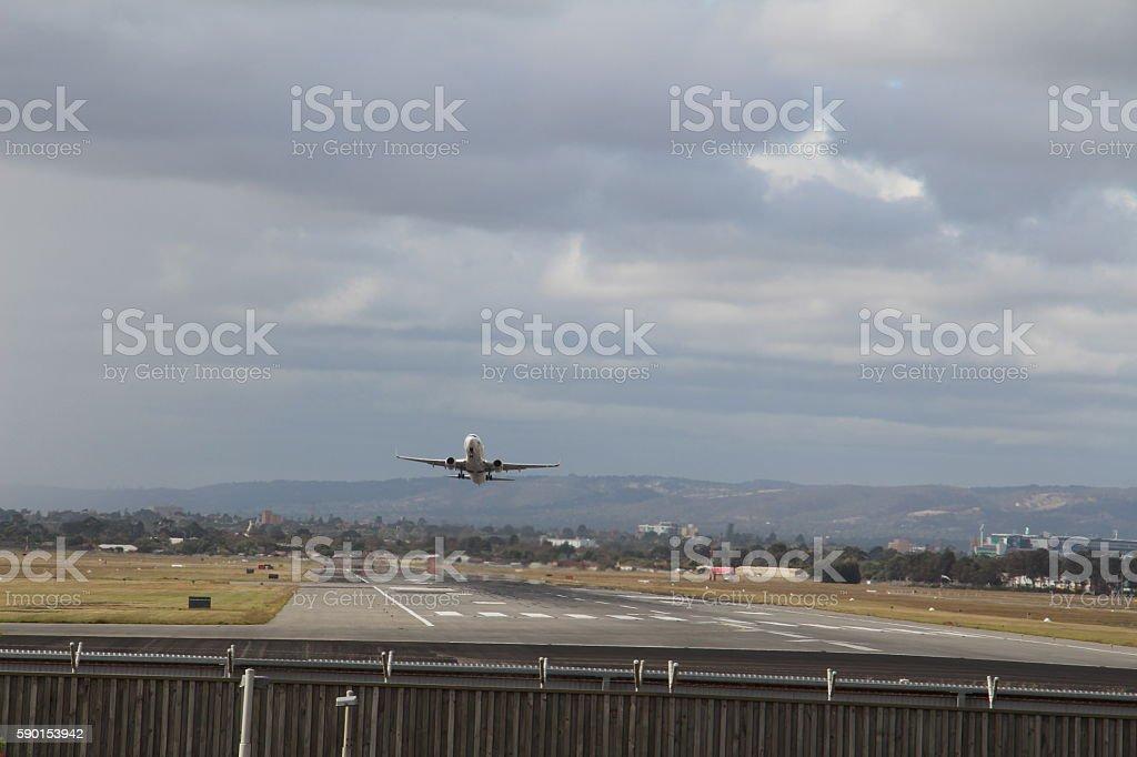 airplane landing adelaide airport gloomy day stock photo