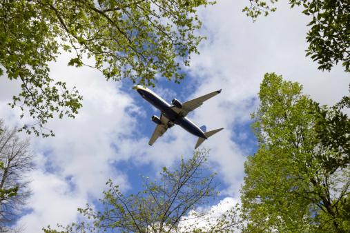 Airplane Landing At The International Pisa Airport Galileo Galilei Stock Photo - Download Image Now